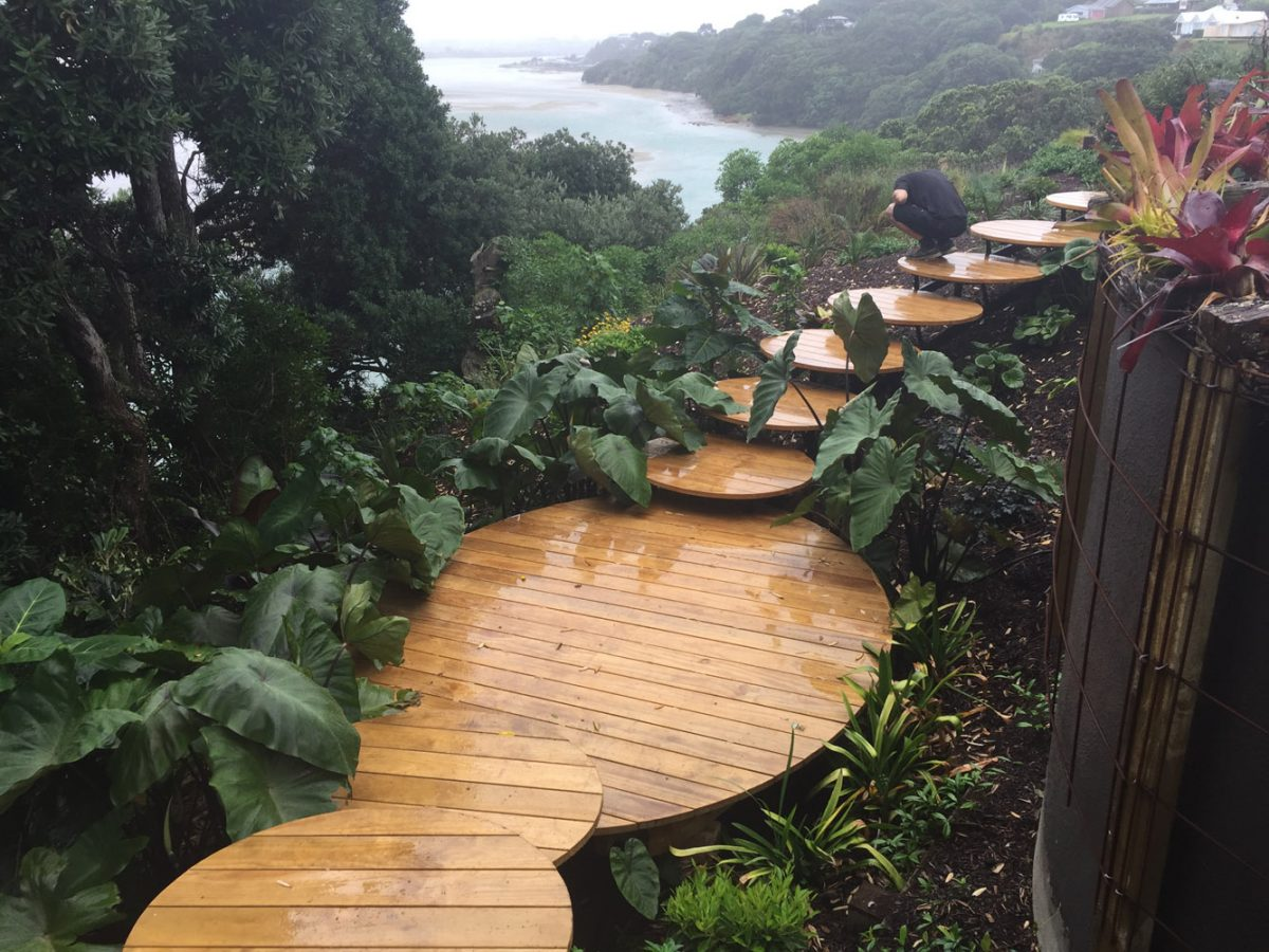 Custom designed outdoor steps down a hillside garden